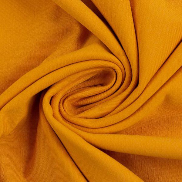 Silti sinepju dzeltena cilpiņu trikotāža
